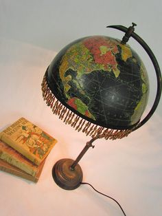 Dishfunctional Designs: Global Recycling: Old Globes Upcycled - Vintage black globe as fringed lampshade!