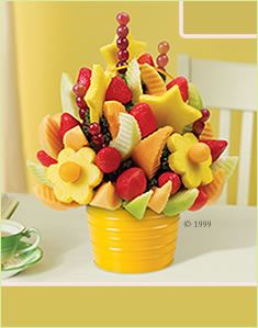 Edible Arrangements.. Maybe a DIY version instead?