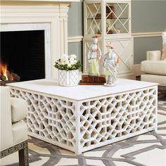 DIY coffee table project- Fancy lattice and a sheet of plywood on top. Maybe have one side with a hinge so we can put baskets underneath for storage