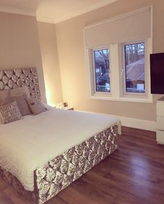 Crushed velvet bed with wooden floor cream & neutral bedroom