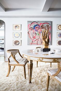 the dining space of natane boudreau: great art & the table is gorgeous.
