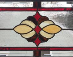 Traditional Cluster Transom - 8 x 40---Stained Glass Window Panel This Is a new Traditional Cluster Transom panel design. It measures 8 x 40. I have used 3/8 visually wide zinc for the frame around it. It has 3 hanging rings on the top long edge; one on each corner and one in the