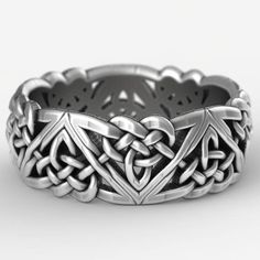A variation on the classic Celtic triangle knot, this more bold motif embodies both the classic elements of Celtic woven designs with more angular and modern design elements. With each knot linked to eachother in one unbroken pattern around the entire rin Celtic Rings, Celtic Wedding Rings, Celtic Knots, Celtic Knot Ring, Viking Rings, Celtic Knot Jewelry, Wedding Bands, Jewelry Tags, Bridal Jewelry