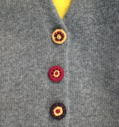 DIY buttons out of metal rings and yarn or embroidery thread.
