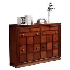 Complete your elegant bedroom or dressing room scheme with this beautiful cherry veneer shoe unit, featuring eight handles. For a plush look, arrange alongside a neutral shag rug and a black leather armchair.  Product: Shoe unitConstruction Material: Cherry veneer and woodColour: CherryFeatures:  Four drawers  Dimensions: 88.9 cm H x 113.1 cm W x 30 cm D Cleaning and Care: Do not expose your furniture to high temperatures or humidity, use a soft cloth dry or slightly damp. Check the ...