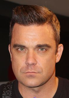 Robbie Williams meets fans and signs copies of his album 'Take The Crown' at HMV, Oxford Street on November 5, 2012 in London, England.