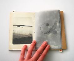 Hand bound photographic book describing two twins separate experiences.