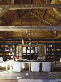 I need a big out building like this with lots of tables and a huge bar and fireplace for a party place
