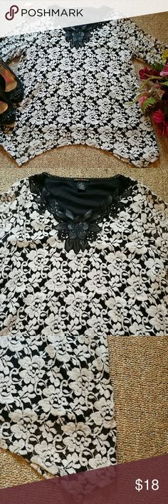 🆕🌹NWOT Black & White Lace Top Stunning Top!! Beautiful lace and scroll work on the neckline. Bodice is lined, sleeves are not. This is a soft fabric and stretchy. I took the tags off but never wore it. Lauren Michelle~ XL 60% cotton 30% nylon 10% spandex. Lining 100% polyester. Hand wash. Lauren Michelle Tops