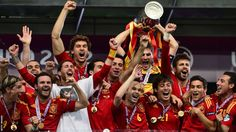 Having lifted the La Liga title with Real Madrid, Spain captain Iker Casillas holds aloft the Henry Delaunay trophy