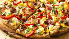 Breakfast Pizza - Wake up to a pizza topped with bacon, eggs and bell pepper that was meant for breakfast!