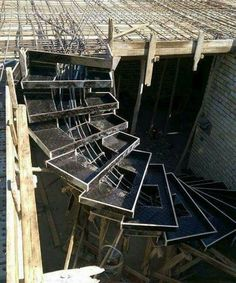 Introduction Formwork is a mould or open box, like container into which fresh concrete is poured and compacted. When the concrete is set, the formwork is Concrete Staircase, Curved Staircase, Stair Railing, Staircase Design, Building Stairs, Steel Stairs, Stair Detail, Modern Stairs, Concrete Structure