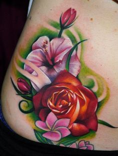 Flower Tattoo Designs - hip Tattoo - tattoos for women....This idea, replace hibiscus with a mum and those other little flowers with violets, keep the rose....