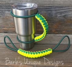 Tumbler Handles This listing is for (1) handmade Tumbler handle. I make them to fit a 20 oz or 30 oz with your choice of 1 or 2 colors. The bungee cord comes in green. Please message me if you would like a custom order. ~~~~~~~~How are they made:~~~~~~~~~ My handles are made with 550 Paracord that is woven tightly into a handle. Wrapped around the tumbler is 1/4 shock cord (bungee cord) USA made. The weave is woven tightly to make the handle strong and sturdy so it does not sag when you pick…
