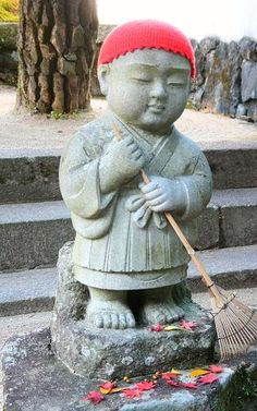 Japanese Jizo Statue (Iwakuni-City, raking leaves buddha hat