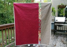 The back is Kona Cerise and a Kona tan color with a simple strip of Parisville fabrics.