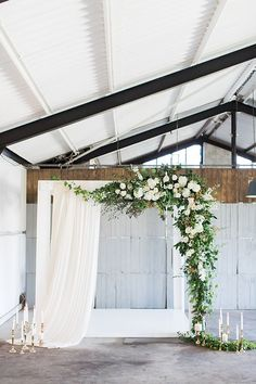 industrial romantic wedding ceremony - photo by Wesley Vorster Photography http://ruffledblog.com/timeless-romance-wedding-inspiration/