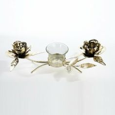 "10.5"" Seasons of Elegance Gold Rose Metal Christmas Candle Holder by Kurt Adler. $16.99. From the Seasons of Elegance CollectionItem #9726Candle holder features two blooming roses with leaves and an antique gold finishHolds one votive candle - not includedDimensions: 10.5""LMaterial(s): metal/glass. Save 15% Off!"