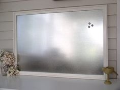 """Grab a sheet of galvanized steel and place in photo frame. Soften the look with pastel paint or hardened with metallic spray, to suit mom's decor style. Galvanized sheet squares available as small as 12""""x12"""" for under $3.00. http://www.onlinemetals.com/merchant.cfm?id=992&step=2&top_cat=849"""