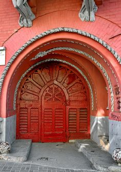 Bright red wooden door in Kiev, Ukraine~