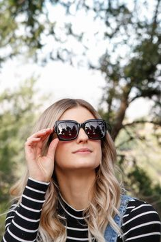 09a1145887 Go for an oversized square frame in Black Mackenzie Shiny TOMS Sunglasses.  Toms Sunglasses