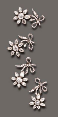 A rare antique set of four Diamond Flower Brooches | Each old European and pear-shaped diamond flowerhead, extending an old mine and old European-cut diamond stem, mounted in silver, (two diamonds deficient), mid 18th century.