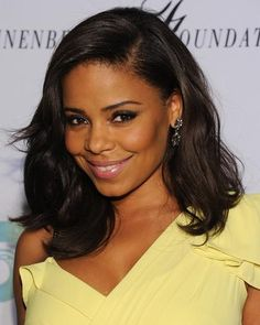 Sanaa Lathan wore her wavy hair and side bangs down to Charlize Theron's Africa Outreach Project October 2011.