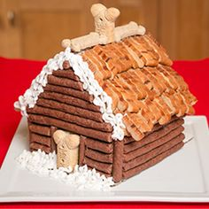 Learn how to make this gingerbread dog house your pup will love! #TreatThePups #MilkBone #MilosKitchen #Pupperoni