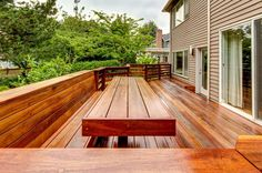 "Craftsman Deck with Pavilion wood decking - exotic ipe / 2""x2"" / 3' to 6' / solid, Built-in seating, Wood railing"