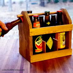 Reusable 6 pack carrier made of wood. Copper handle has built in bottle opener.  on etsy  coldcreekbrewing