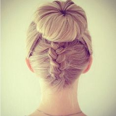 A bun with a french braid from the bottom of the head.