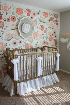 Floral Wall Mural in a Baby Girl Nursery - gorgeous design with pops of gold, coral and light pink. Dreamy!