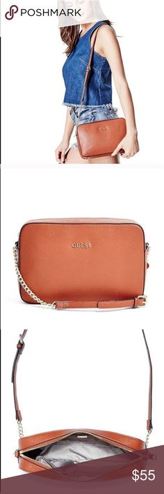 """GUESS ISABEAU LARGE CROSSBODY SOLD OUT in stores/ online GUESS ISABEAU LARGE CROSSBODY tan cognac color Faux-leather saffiano-textured crossbody features gold-tone hardware and front logo emblem. Interior pockets and logo-print lining. Top zipper closure. Crossbody strap with 21"""" drop. 10""""W x 7""""H x 2""""D one micro blemish in the front of the bag that is hard for my camera to capture but please see the last pic that shows the finest  dots on bottom left but otherwise flawless condition. Guess…"""