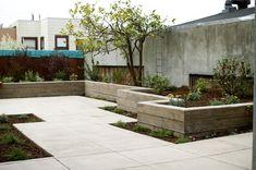 concrete patio, concrete wall, planting beds   Yelp