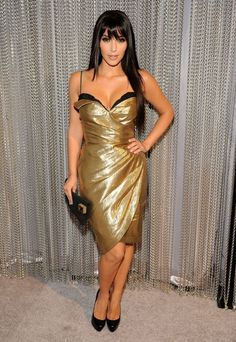 Kim Kardashian wearing Christian Louboutin Alti Pumps Thierry Mugler Gold Lame Bustier Dress Pierre Hardy Clutch Bag. Kim Kardashian Spike TV 2008 Video Game Awards December 14 2008.