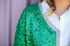 Daytime sparkle - green sequined cardigan with a grey, jersey trim