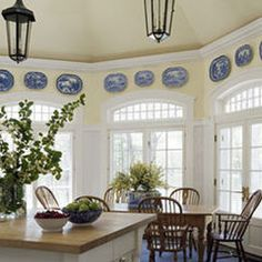 traditional dining room by Austin Patterson Disston Architects like the windows and the platters above the windows