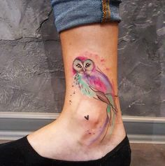Bright and colorful watercolor owl done on girl's ankle by Simona Blanar, an artist based in Prague, Czech Republic.