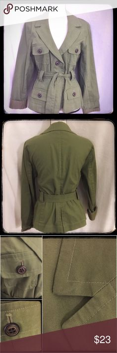 """Classic Belted Olive Khaki Jacket Classic design and in great condition, this belted jacket by Envision Avenue is beautiful. The thicker cotton weave and wooden button Appeal make this one of those jackets that will be one of those """"go to"""" fashion pieces. This appears to be NWOT, but I didn't list as that because I couldn't verify on this one. The size states large, but if you like to wear it looser, this would be closer to a medium. It would be a more fitted large. Pristine condition and…"""