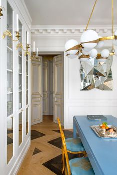 from NYT, designer Alexis Mabille's apartment. Chandelier to die for!