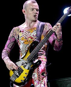 Flea (1962 - present), Red Hot Chilli Peppers - No way you can have anything about bass players without Flea. One of my main influences, the flamboyant and colourful Flea is an amazing bassist, with clear influences of punk and funk in his playing. As famous for pretty much being nude all the time (save for a strategic sock) as he is for being a founder member of the Chilli Peppers, Flea is a major influence on bassists everywhere. Listen to If You Have To Ask, Higher Ground and Dani…