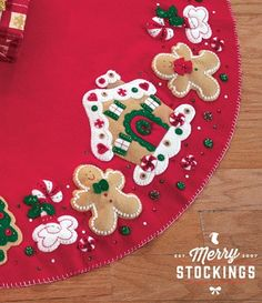 http://www.merrystockings.com/christmas-stocking-kits/bucilla-tree-skirts/gingerbread-house-bucilla-tree-skirt.html