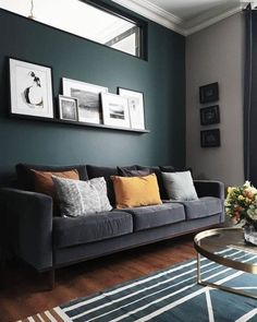 Dark walls, grey velvet sofa, prints on a shelf and mustard cushions in this living room – grey Dark Green Living Room, Dark Walls Living Room, Living Room Color Schemes, Living Room Paint, Living Room Carpet, Living Room Sofa, Home Living Room, Living Room Decor, Charcoal Sofa Living Room