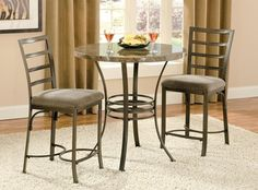 The Collison Collection features durable metal and a faux marble table top. This 3 piece set includes the Collison counter table and 2 counter chairs with upholstered seats. Table Size: x x
