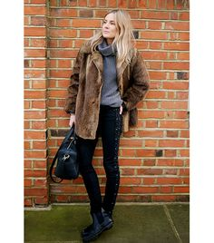 Kate Moss inspiration: For your next casual evening out, don a slouchy gray turtleneck, lace-up black jeans, and a faux fur jacket. Finish with bedhead and Chelsea boots (another bastion of British style).