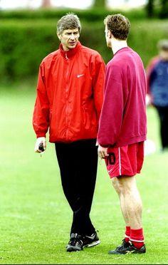 Arsenal manager Arsene Wenger talks tactics with with Dennis Bergkamp. 9 April, 1999.