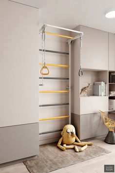 A kids' gymnastic climbing wall has been coloured to match the rest of the decor, with yellow and grey ladder rungs, and contrasting hand grips. home accent Family Home With Reserved Red & Yellow Accents Kids Room Accessories, Modern Grey Sofa, Playroom Design, House Beds, Apartment Interior, Kids Bedroom, Home And Family, House Design, Interior Design