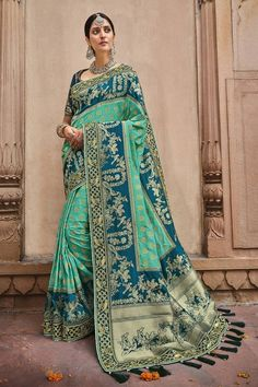 Mirraw provides this lovely drape as a must-have pieces for your wardrobe. With this light blue and teal silk traditional saree, you may be your own style and design diva. #banarasisarees #banarasisareelookforwedding #banarasisareeblousedesign #banarasisilksaree #banarasisareeblousedesignslatest #sareestyles #saree #sareewedding #sareegown #sareedesignspartywear #indianweddingoutfits #indianfashion #indiandesignerwear #indianbridalfashion #weddingdresses #wedding #bridalblousedesigns Art Silk Sarees, Banarasi Sarees, Traditional Silk Saree, Indian Bridal Fashion, Work Sarees, Green Silk, Mint Green, Embroidered Blouse, Embroidered Patch