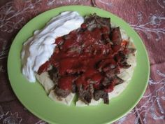Iskender Kebab! My absolute favourite Turkish dish! Roasted pide bread, döner, tomato sauce. I usually put the yoghurt on top of the tomato sauce and swirl it a bit while eating to mix the flavours!