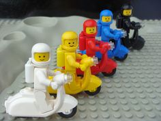 #white #yellow #red #blue and #black #Lego #toys on #Vespa #scooter
